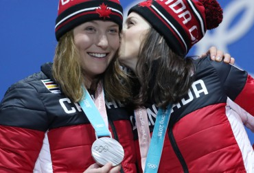 Canada's Kelsey Serwa, right, and Brittany Phelan celebrate their gold and silver medals during a medal presentation ceremony at the PyeongChang 2018 Olympic Winter Games in Korea, Friday, February 23, 2018. THE CANADIAN PRESS/HO - COC Ð David Jackson